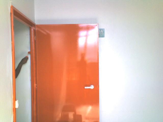 Foto - Adequação de porta corta fogo chumbamento, instalação e pintura