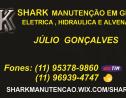Logo da empresa shark manutenção
